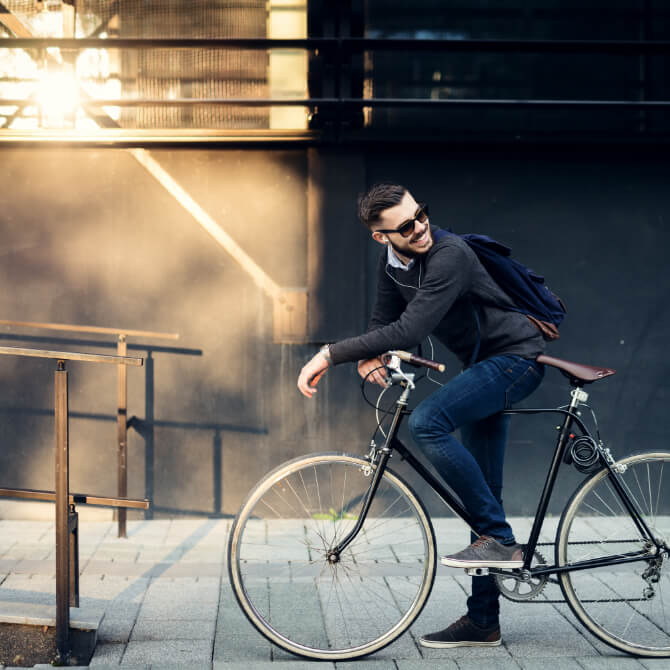 a guy on his bicycle looking back